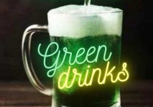 A pint of green beer overlaid with words green drinks with a heading of Zoom Meet Up